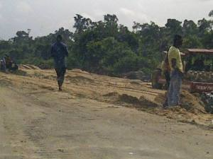 Deep excavations (on the right) and soil reclamation at the Bayelsa Section